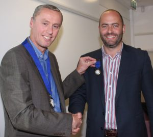 Incumbent Chair Paul Turner awards Mike Bagshaw his Past Chair medal