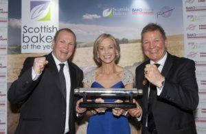 Brothers Gordon and Iain McGhee recieve their Scottish Baker of the Year Award with Mich Turner MBE