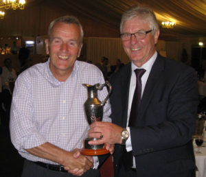 Richard Westaway receives the BSB Trophy from Keith Houliston