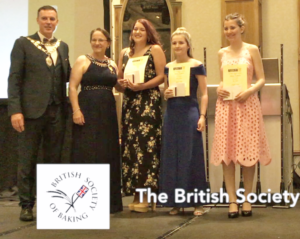 Presentation of the BSB Trophy to Katy Hunt at the 2018 ABST Conference. From the left: Jimmy Griffin, ABST President; Sara Autton, Immediate Past President; Katy Hunt, winner,;Kelsey Young, second; and Eva Spratt, third.